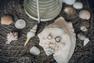 Edgewater House Wedding, Gig Harbor, WA | Beach and nautical themed wedding ring photo idea with seashells | Seattle Wedding Planner, Perfectly Posh Events | Mike Fiechtner Photography