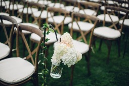 Edgewater House Wedding, Gig Harbor, WA | Vineyard chairs for waterfront ceremony with cream and blush flowers for aisle decor | Seattle Wedding Planner, Perfectly Posh Events | Mike Fiechtner Photography | Floral Design by Stacy Anderson Floral | Rentals by CORT Party Rentals
