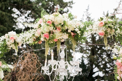 Thornewood Castle Wedding in Seattle | Breathtaking ceremony floral installment with crystal chandelier | Perfectly Posh Events, Seattle Wedding Planner | Stephanie Cristalli Photography | Aria Style