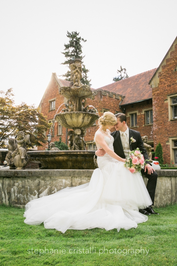 Thornewood Castle Wedding in Seattle |Bride and groom sitting at water fountain at Thornewood Castle in Seattle | Perfectly Posh Events, Seattle Wedding Planner | Stephanie Cristalli Photography