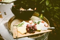 DeLille Cellars wedding in Woodinville | Wine barrel with cheese platter and bread | Perfectly Posh Events | Seattle Wedding Planner | Andria Lindquist Photography | Twelve Baskets Catering