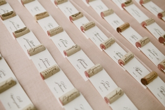 DeLille Cellars wedding in Woodinville | Blush tablecloth with DeLille wine corks as escort cards | Perfectly Posh Events | Seattle Wedding Planner | Andria Lindquist Photography
