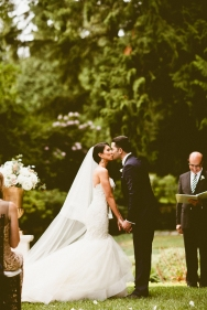 DeLille Cellars wedding in Woodinville | Bride & groom first kiss, outdoor ceremony | Perfectly Posh Events | Seattle Wedding Planner | Andria Lindquist Photography