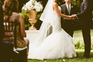 DeLille Cellars wedding in Woodinville | Perfectly Posh Events | Bride in Ceremony with gold floral vase and blush peonies | Seattle Wedding Planner | Andria Lindquist Photography