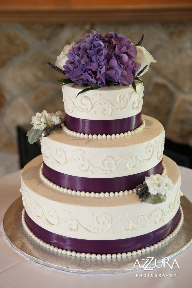 Laurel Creek Manor Wedding in Seattle   Purple hydrangea cake topper on three-tiered wedding cake with purple ribbon   Perfectly Posh Events, Seattle Wedding Planner   Azzura Photography   Sublime Stems