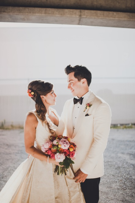 Venue: The Foundry by Herban Feast, Seattle WA | Floral Design: Butter & Bloom | Wedding Planning & Design: Perfectly Posh Events, Seattle Wedding Planner | Photographer: Carina Skrobecki Photography | mid-century modern wedding with bride and groom, white tux for groom