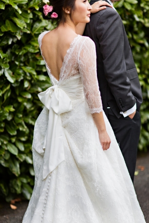 Robinswood House Wedding in Bellevue   Lace bridal gown with large back bow   Perfectly Posh Events, Seattle Wedding Planner   Courtney Bowlden Photography