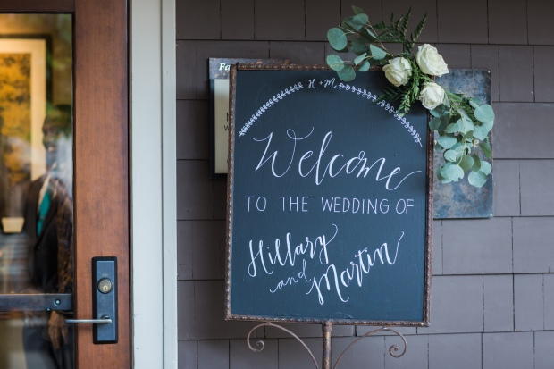 Salish Lodge Wedding in Seattle | Welcome sign with greenery swag and hand-done calligraphy | Perfectly Posh Events | Amy Galbraith Photography | Butter & Bloom | Songbird Paperie | Salish Lodge