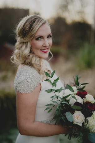 Cedarbrook Lodge wedding in Seattle | Stunning, winter bride with dark, romantic bouquet and beaded-shouldered gown | Perfectly Posh Events | Carly Bish Photography | Butter & Bloom