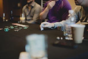 Cedarbrook Lodge wedding in Seattle | Groomsmen playing poker before getting ready for wedding day | Perfectly Posh Events | Carly Bish Photography