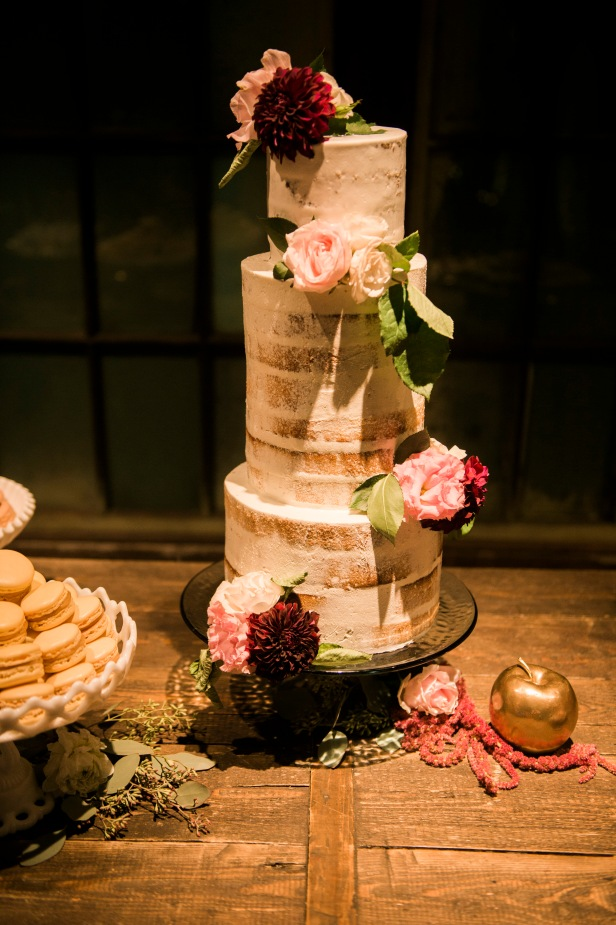 Sodo Park Wedding in Seattle | Three-tiered, romantic, naked wedding cake with pink and burgundy flower accents | Perfectly Posh Events | Kimberly Kay Photography | Honey Crumb Cake Studio