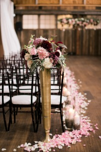 Sodo Park Wedding in Seattle |Tall, golden aisle marker urns with pink, cream, and burgundy floral arrangements | Perfectly Posh Events | Kimberly Kay Photography | Floressence