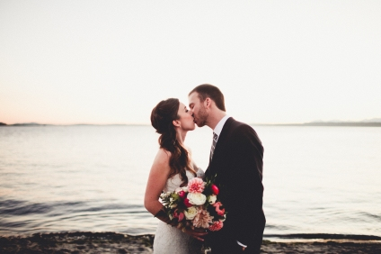Bride and Groom kiss at sunset in Seattle, Pink and White wedding bouquet by Stacy Anderson Design, dahlias and ranuculus | Golden Gardens Bathouse Wedding | Perfectly Posh Events, Seattle Wedding Planner | Andria Linquist Photography | Holly + Dustin Wedding // © Andria Lindquist 2014