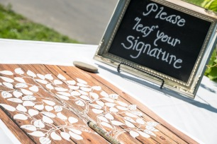 Wooden sign with tree and leaves for guests to sign as guestbook   Meadowbrook Farm Wedding, Snoqualmie, WA   Perfectly Posh Events, Seattle Wedding Planner   Sasha Reiko Photography   Jesse + Wes Wedding // © Sasha Reiko Photography