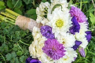 White, ivory, and various shades of purple bridal bouquet with burlap and lace wrap   Meadowbrook Farm Wedding, Snoqualmie, WA   Perfectly Posh Events, Seattle Wedding Planner   Down to Earth Flowers   Sasha Reiko Photography   Jesse + Wes Wedding // © Sasha Reiko Photography