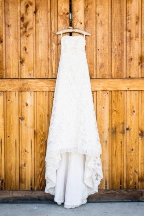 Ivory lace wedding gown hanging on barn door   Meadowbrook Farm Wedding, Snoqualmie, WA   Perfectly Posh Events, Seattle Wedding Planner   Sasha Reiko Photography   Jesse + Wes Wedding // © Sasha Reiko Photography