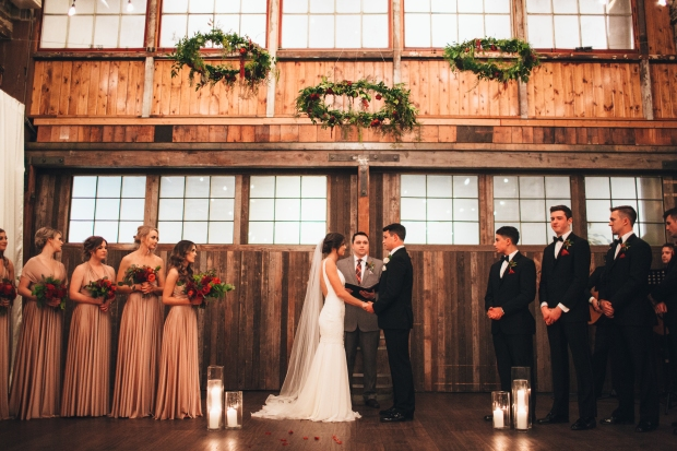 Sodo Park Wedding, Seattle WA | Wedding ceremony under trio of suspended greenery hoops | 2017 Pantone Color of the Year, Greenery | Designed + Coordinated by Perfectly Posh Events | Paige Jones Photography | Floral Design by Butter & Bloom