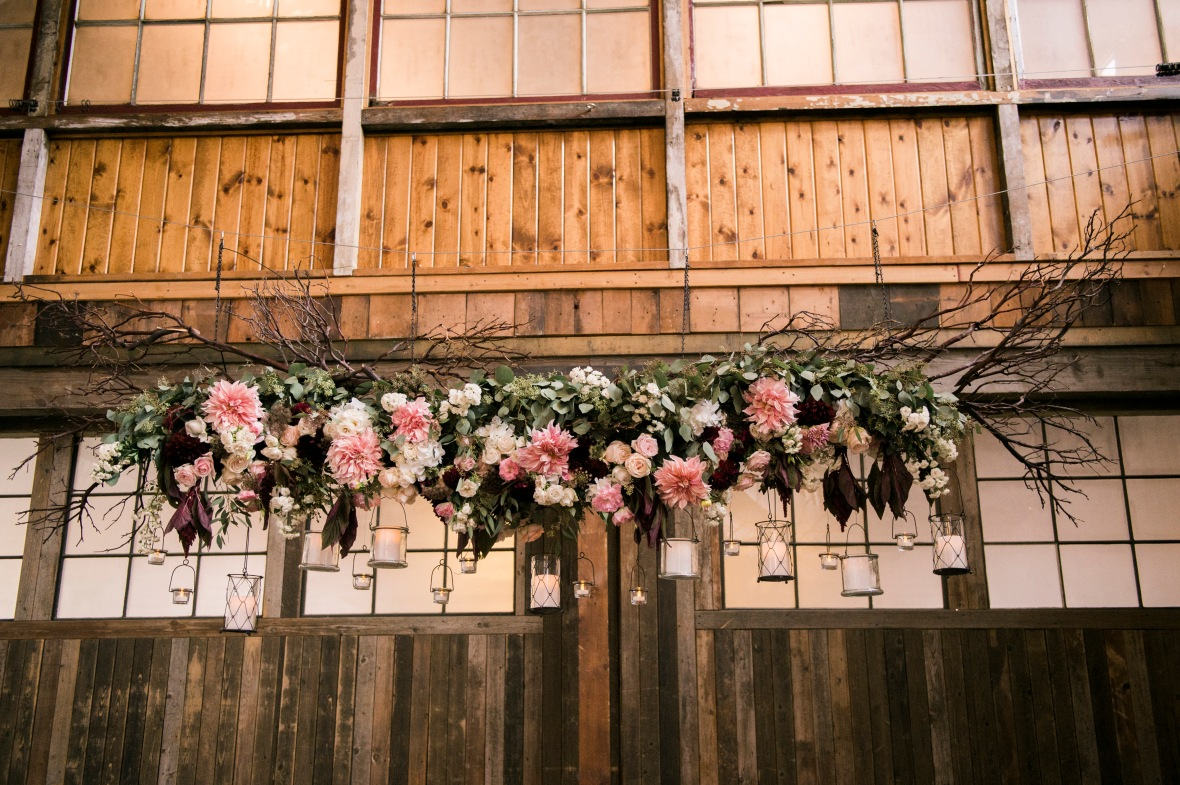 Hanging greenery and flower chandelier | Sodo Park Wedding in Seattle | Wedding Planning and Design by Seattle Wedding Planner Perfectly Posh Events | Kimberly Kay Photography | Floressence