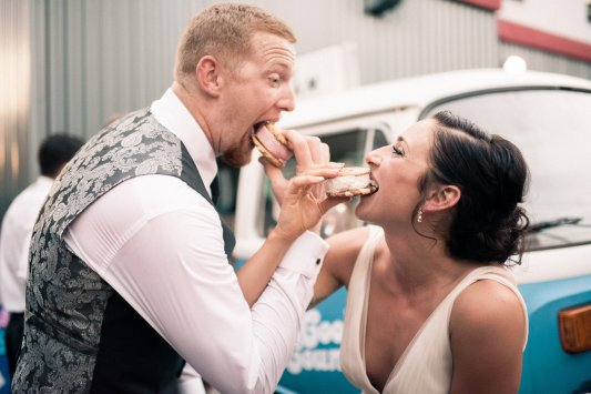 Makayla and Johnny's Wedding at Fremont Foundry in Seattle | Alexandra Grace Photography | Wedding Planning by Perfectly Posh Events, Seattle Wedding Planner | Bride and groom eat ice cream sandwich at wedding instead of cake