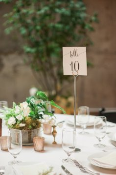 Makayla and Johnny's Wedding at Fremont Foundry in Seattle | Alexandra Grace Photography | Wedding Planning by Perfectly Posh Events, Seattle Wedding Planner | Greenery and white centerpiece, urban chic wedding, calligraphy table number, trees and concrete