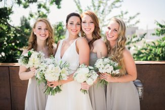 Makayla and Johnny's Wedding at Fremont Foundry in Seattle | Alexandra Grace Photography | Wedding Planning by Perfectly Posh Events, Seattle Wedding Planner | Bridesmaids in dove grey dresses with white flower bouquets