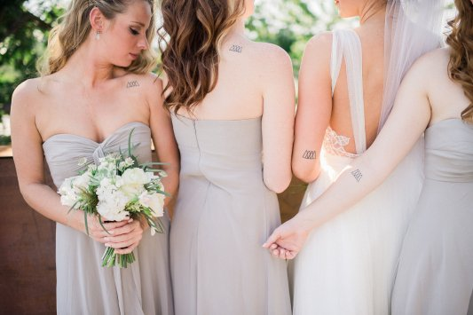 Makayla and Johnny's Wedding at Fremont Foundry in Seattle | Alexandra Grace Photography | Wedding Planning by Perfectly Posh Events, Seattle Wedding Planner | Bridesmaid tattoos, dove grey bridesmaid dress, white bridesmaid bouquet