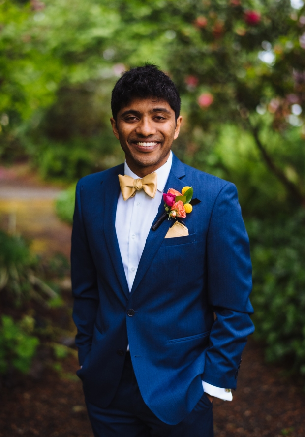 Kiana Lodge Wedding on Bainbridge Island, WA | Groom in navy suit with contrasting vibrant colored boutonniere with yellow, pink and orange blooms | Perfectly Posh Events, Seattle Wedding Planning | Shane Macomber Photography | Floral Design by Flora Nova
