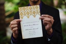 Kiana Lodge Wedding on Bainbridge Island, WA | Elaborate gold design on ceremony program | Perfectly Posh Events, Seattle Wedding Planning | Shane Macomber Photography
