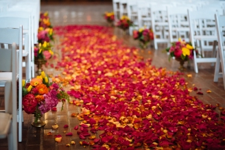 Kiana Lodge Wedding on Bainbridge Island, WA | Stunning blanket of pink and yellow petals scattered across ceremony aisle | Perfectly Posh Events, Seattle Wedding Planning | Shane Macomber Photography | Floral Design by Flora Nova