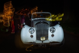 Kiana Lodge Wedding on Bainbridge Island, WA | Glow stick sendoff in vintage Rolls Royce at end of colorful PNW wedding reception | Perfectly Posh Events, Seattle Wedding Planning | Shane Macomber Photography | Floral Design by Flora Nova