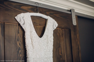 Hotel Ballard Wedding in Seattle | Beaded, capped sleeve wedding dress in getting ready room of Hotel Ballard | Perfectly Posh Events, Seattle Wedding Planner | Mike Fiechtner Photography