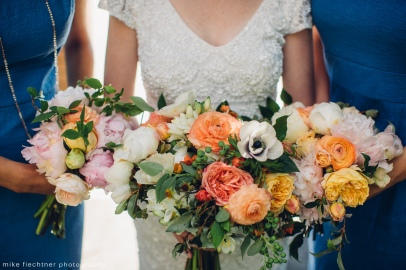 Hotel Ballard Wedding in Seattle | Stunning garden style bouquets of orange and white with blue bridesmaid dresses | Perfectly Posh Events, Seattle Wedding Planner | Mike Fiechtner Photography | Floral Design by The London Plane
