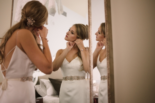 Axis Pioneer Square Wedding in Seattle | Seattle bride getting ready in classic, sleek wedding gown with beaded belt | Perfectly Posh Events, Seattle Wedding Planner | Roland Hale Photography