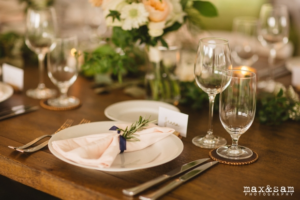 The Lodge at Fall City Wedding in Seattle, WA | Long head table with blush napkins tied with navy silk ribbon and an herb | Perfectly Posh Events, Seattle Wedding Planner | Floral Design by Sugar Pine | Napkins from Choice Linens | Max & Sam Photography