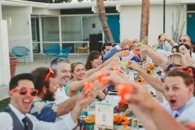 The Monkey Tree Hotel, Palm Springs wedding venue   group of wedding guests having drinks   Perfectly Posh Events, Seattle and Portland Wedding Planner