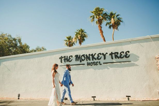 The Monkey Tree Hotel, Palm Springs wedding venue   bride and groom in front of hotel sign   Perfectly Posh Events, Seattle and Portland Wedding Planner